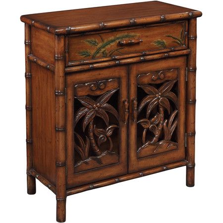 Wood Cabinet With Bamboo Inspired Details Showcases 1 Drawer And 2 Doors Carved Palm Tree Designs Product