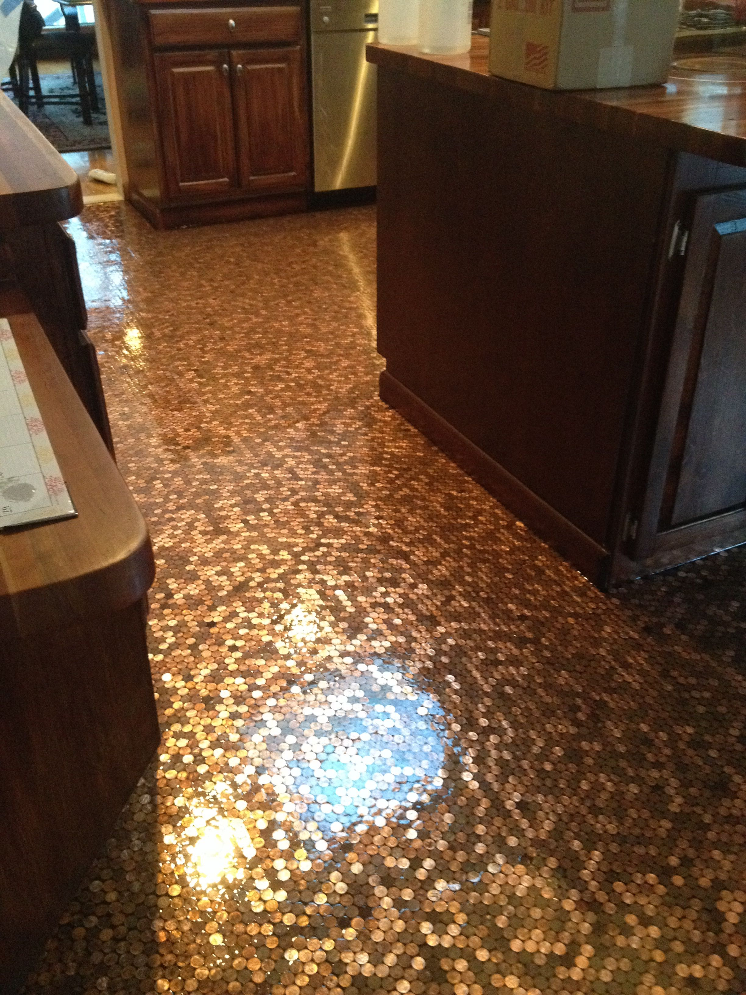 Penny floor I put in my kitchen 50000 pennies covered