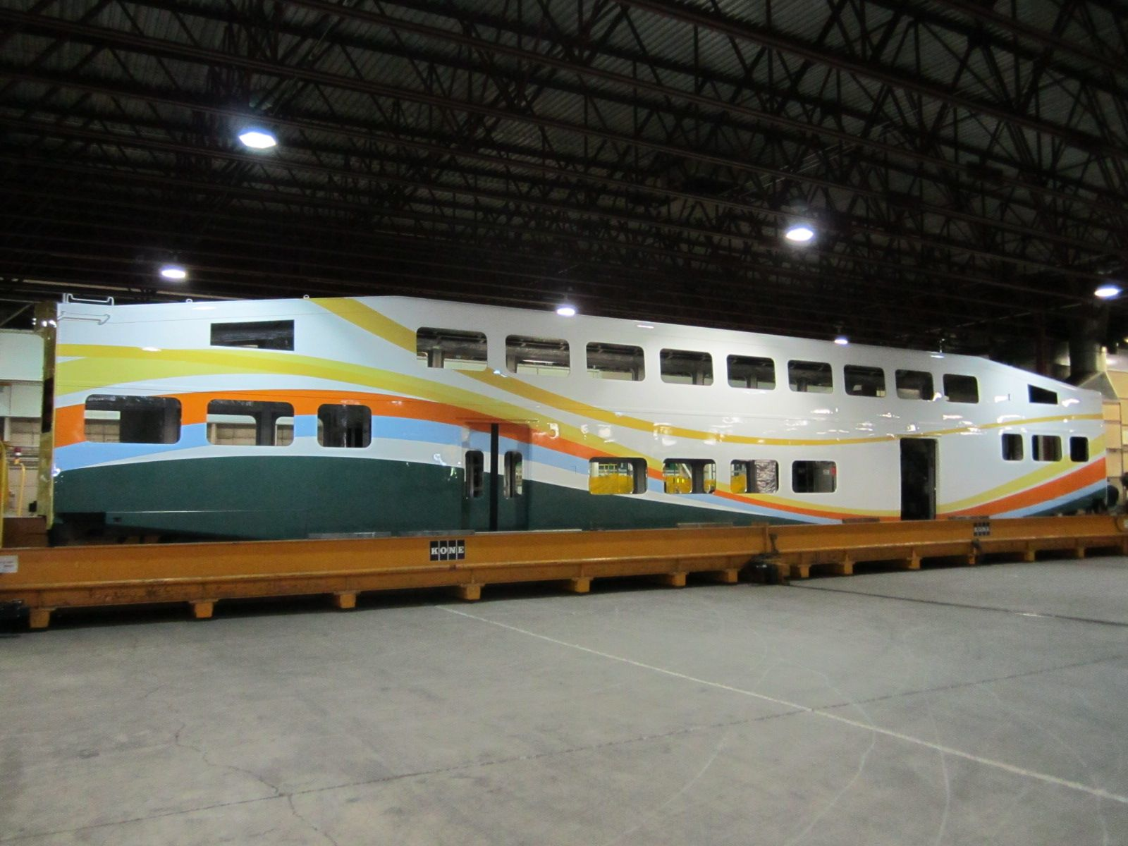 sunrail trains will be painted in bright vibrant colors that