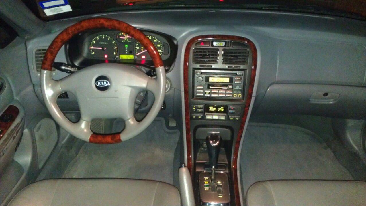Make kia model optima year 2004 body style sedan exterior color