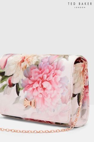 a12ea360a3a8 Florals to last you a lifetime with this BEAUT Ted Baker floral clutch bag.  We think our wedding outfit may be complete now.