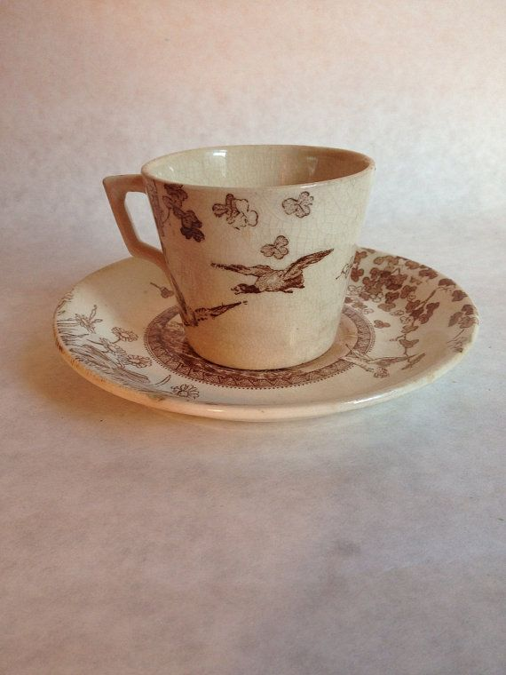 I like asymmetrical patterned transferware like this..... Woodland brown pattern from Brownfields and Son For by Valentique, $25.00