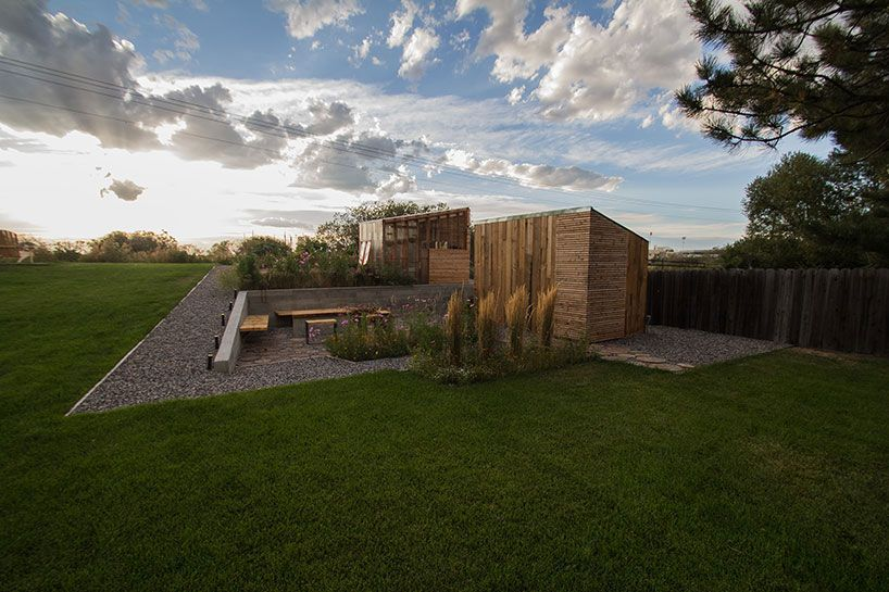view towards the fire pit, storage and green house image © good design collective
