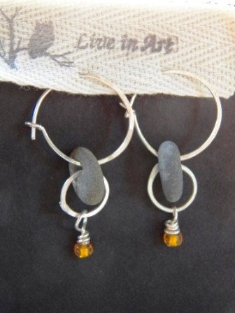 River Rock Earrings with hammered sterling silver and orange bead. $42.00, via Etsy.