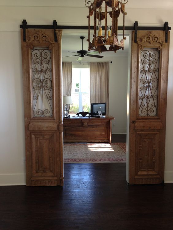 Our antique French iron exterior doors hung