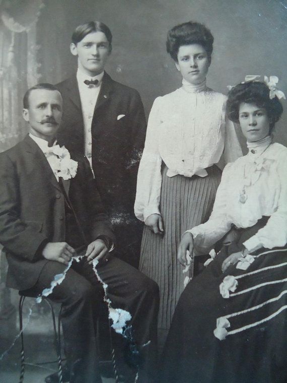 Victorian black and white 1900s photo of a beautiful family portrait very
