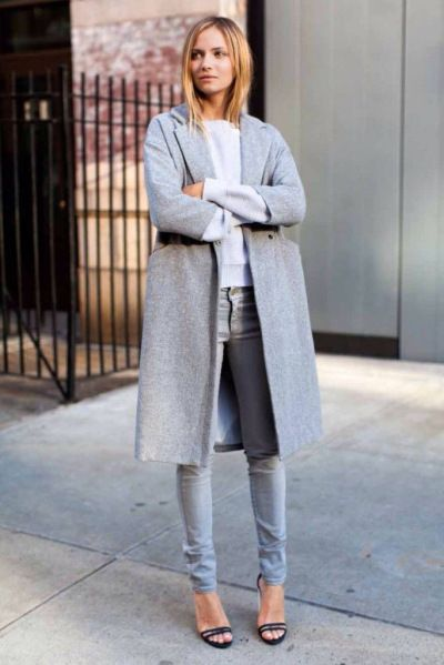 Minimal and classic- grey coat, white long sleeves, faded blue denim jeans, black heels with 2 thin straps on display- woman's fashion and street style- simplified