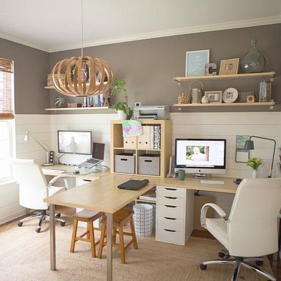 yet another awesome double desk home office idea love that there is a table extended where they connect a nice little extra dining room in addition to