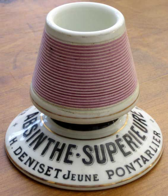 orcelain matchstrikers, known as Pyrogene after one of the major manufacturers, were a feature of every bistrot table. Many carried advertising for the leading absinthe marques. The striking surface was usually porcelain, occasionally a wooden insert.