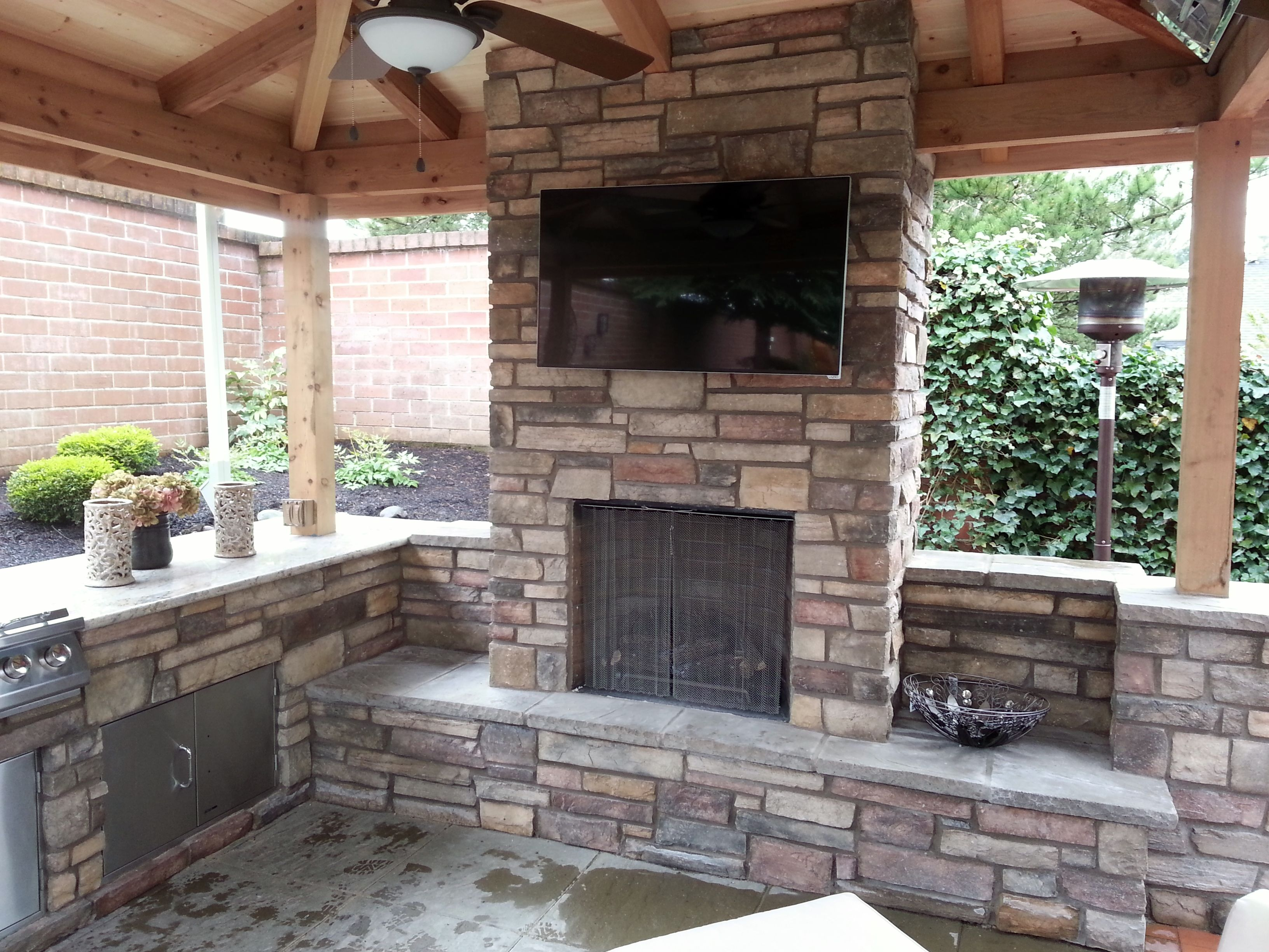 Outdoor Fireplace Living Kitchen Covered Patio Granite Countertops Stone Columns Tv Above Www Brownbrosmasonry