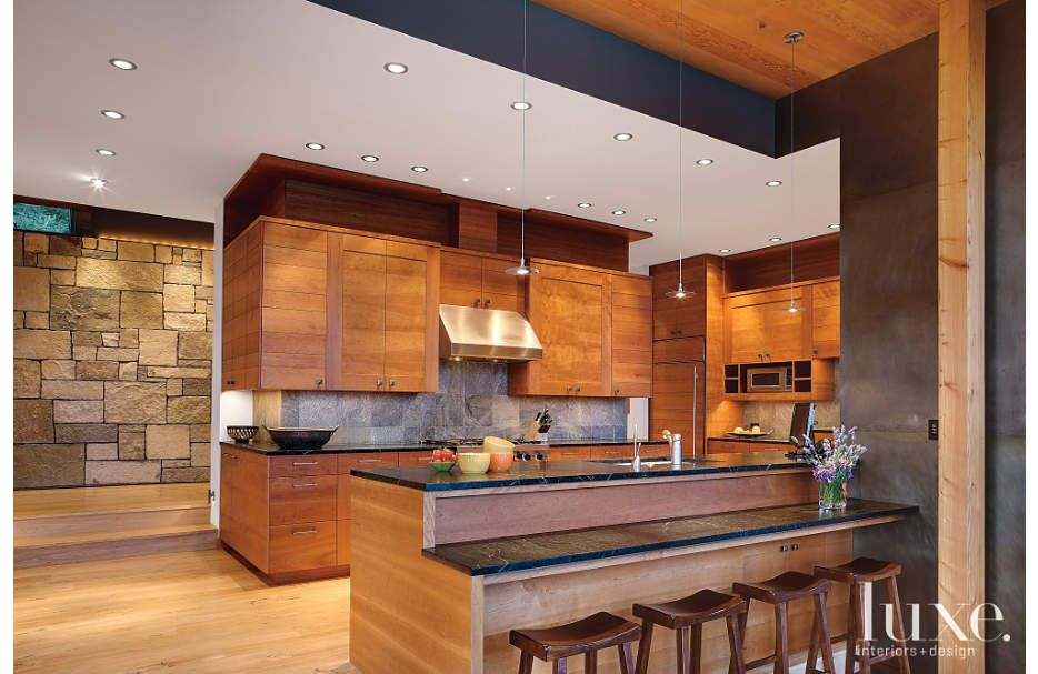 In this contemporary kitchen, cherrywood by