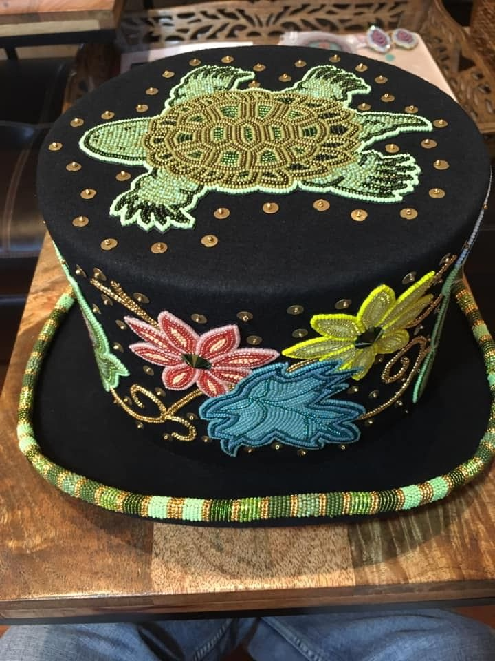 Ojibwe floral beaded top hat by Adam Avery. Beaded hat