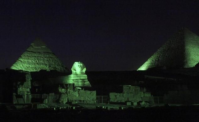 Pyramids and the sphinx are lit in green light ahead of St Patricks Day, Irelands National Day, at the Pyramids plateau, March 14, 2013. Tourism Ireland has planned for prominent landmarks around the world to be illuminated in green light for St Patrick's Day, which falls on March 17.  REUTERS-Asmaa Waguih