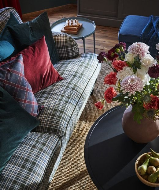 overhead view of a tartan sofa and coloured cushions next