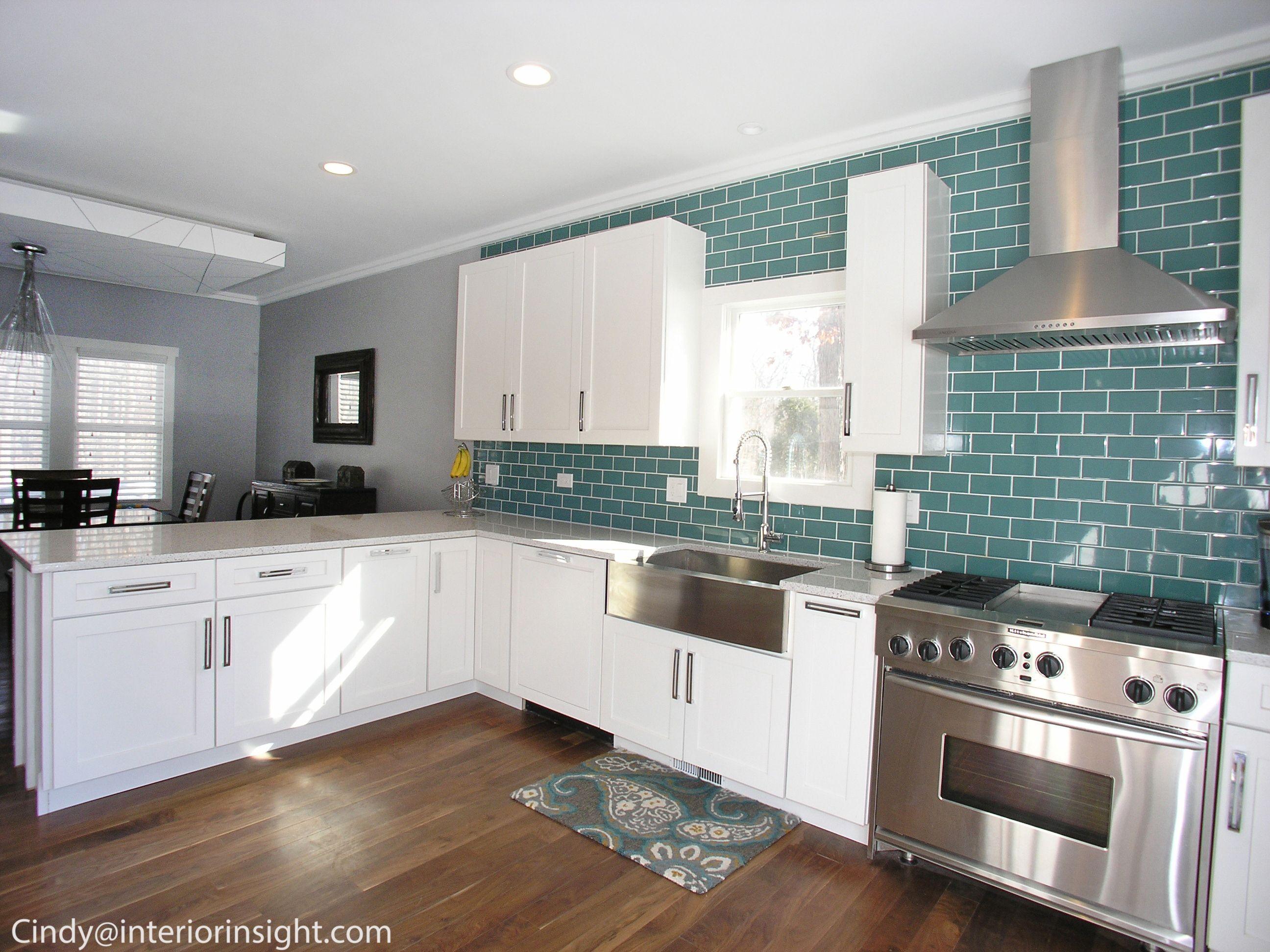 Teal glass backsplash in this modern white open floorplan - Teal kitchen appliances ...