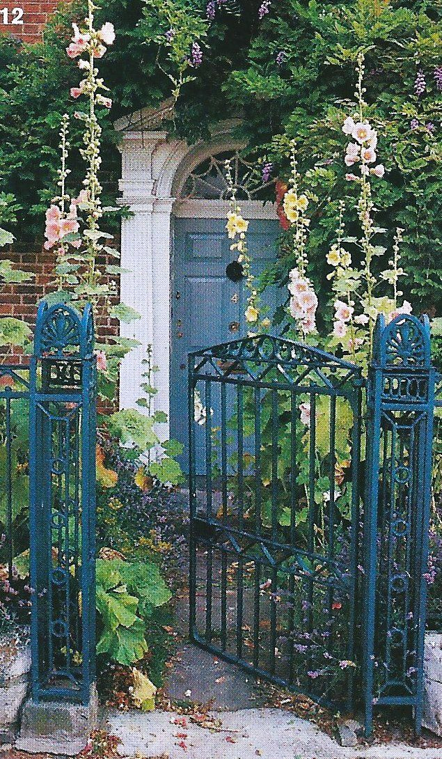 Iron gate and fence with shallow front garden foundation