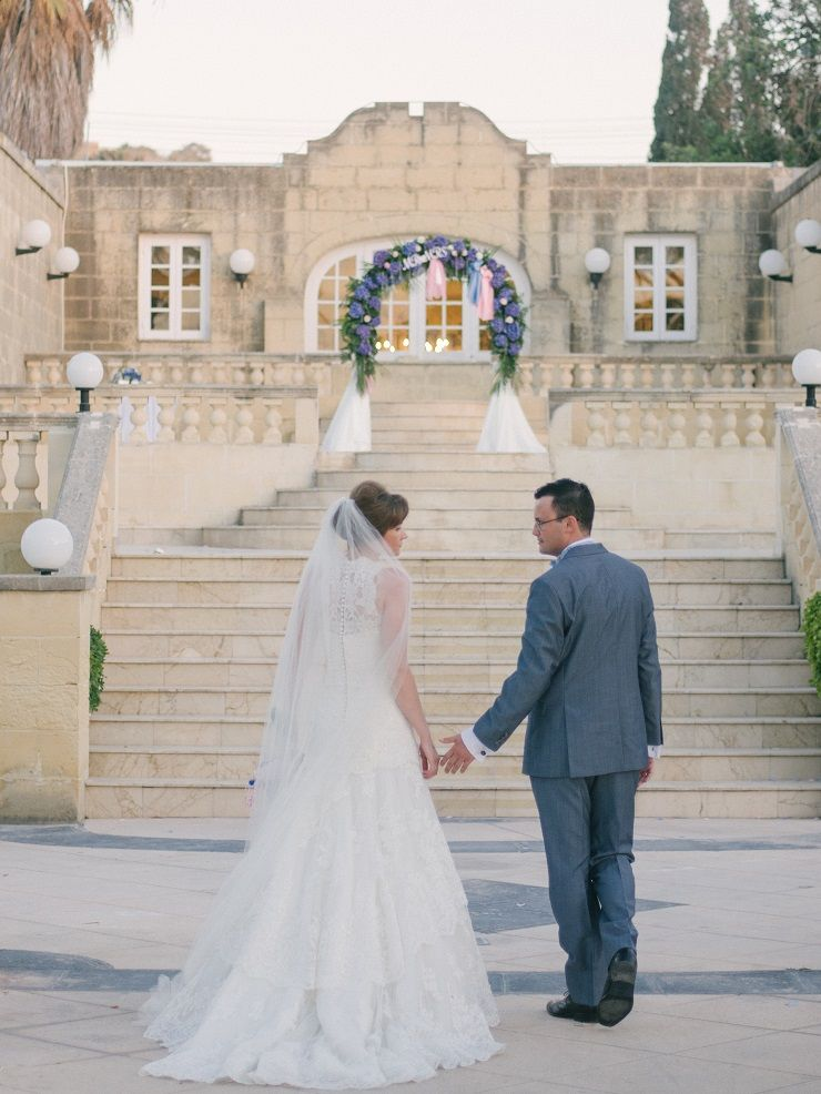 An Indigo Hydrangea Bouquet and ceremonial archway For A Wedding In Malta Island