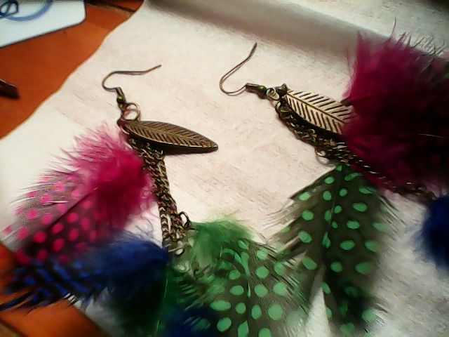 antique gold wires and findings with new guinie feathers dangle style