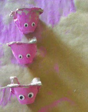 a simple toddler craft project, painting pigs. an upcycle craft using egg cartons to create sensory play pigs