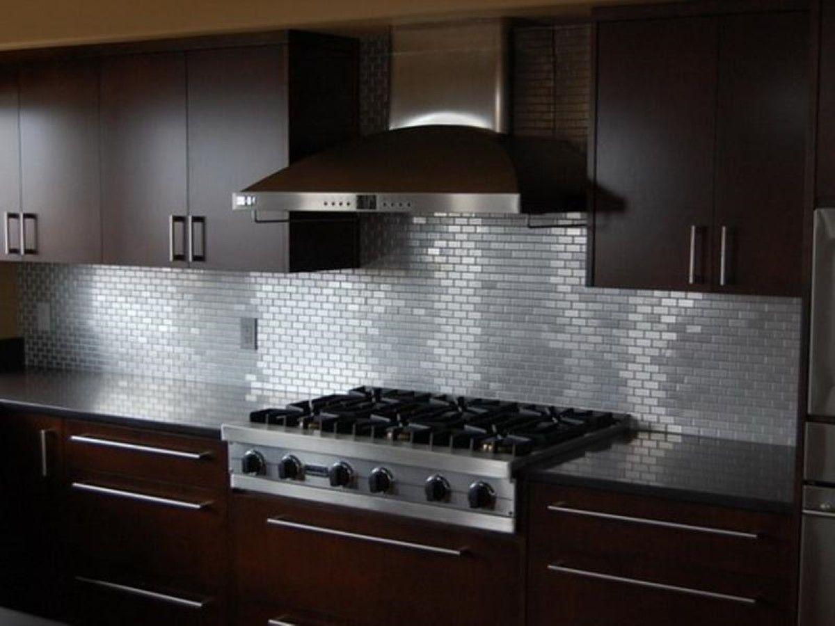 Gorgeous Kitchen With Maroon Cabinets Also Solid Countertop And Metal Subway Til Modern Kitchen Backsplash Kitchen Wall Tiles Design Kitchen Backsplash Designs