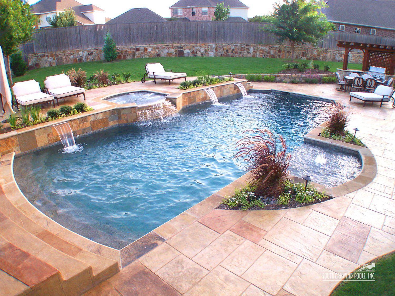 this is a nice space  the landscaping makes an already beautiful pool area shine even more