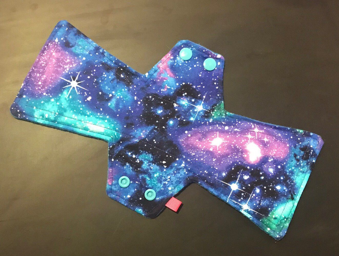 Excited to share the latest addition to my #etsy shop: 11 inch moderate flow reusable menstrual sanitary cloth pad 2.5 snap width slim pad galaxy cotton print #noveltyfabric #11inchclothpads #clothmenstrualpad #clothpads #reusableclothpad #reusablepads #clothsanitarypads