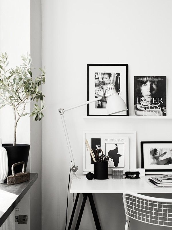 Black and white framed fashion prints.
