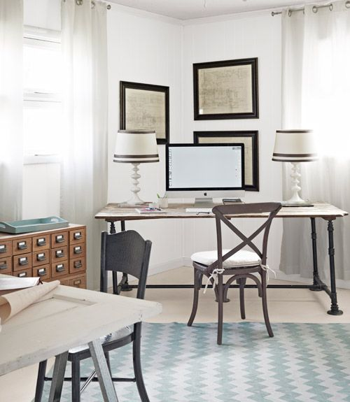 These home office desks are made from salvaged pipes and old doors.