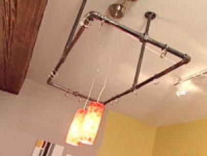 Dress Up Your Kitchen With These Steps From DIYNetwork.com On How To Build  A Hanging Pot Rack Using Pipe And Simple Hooks.