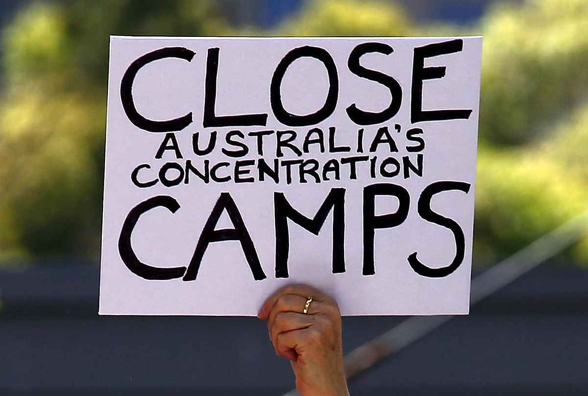 """Share or Comment on: """"AUSTRALIA: Dutton Rules Out Settling 800 Asylum Seekers"""" - http://www.politicoscope.com/wp-content/uploads/2016/04/A-protester-holds-a-placard-during-a-rally-in-support-of-refugees-in-central-Sydney-Australia.jpg - Immigration Minister Peter Dutton stressed the success of Australia's hard-line policy strongly criticised by the United Nations and human rights agencies.  on Politicoscope: Politics - http://www.politicoscope.com/2016/04/27/australia-dutton-"""