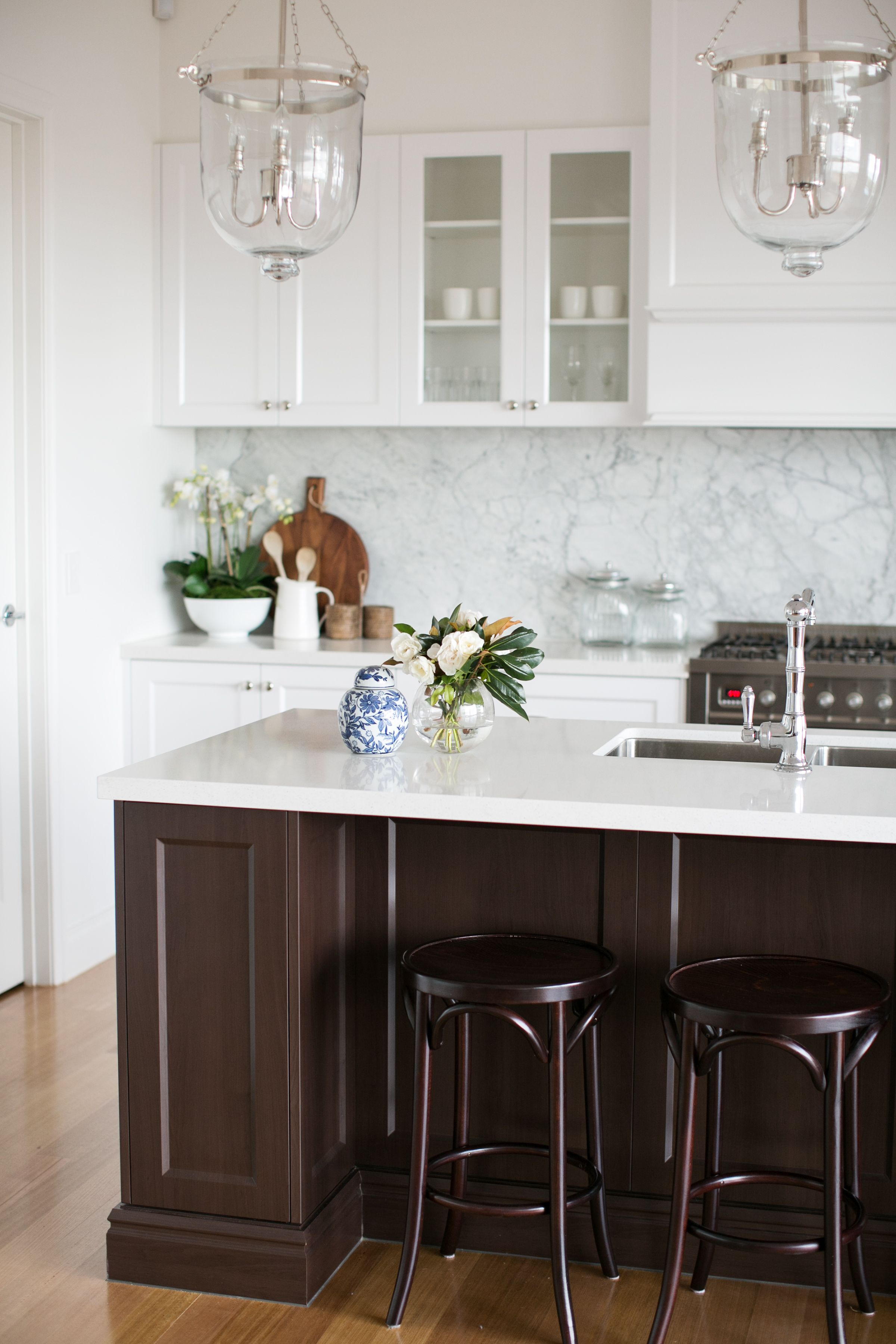 Hampton style kitchen with contrast dark island and bentwood stools ...