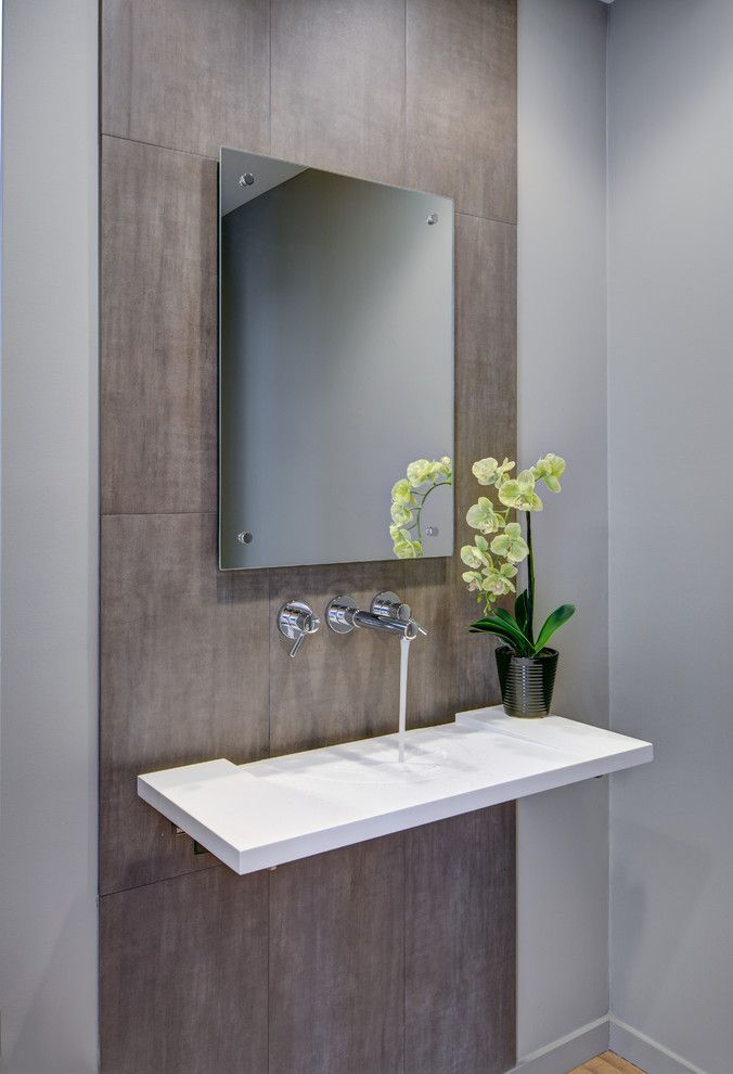 Glamorous frameless mirrors in Powder Room Contemporary with Floating Sink next to Frameless Mirror alongside Cool Bathrooms and Handicap Toilet #modernpowderrooms