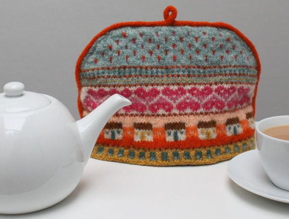 This colourful Fair Isle inspired tea cosy features little ...