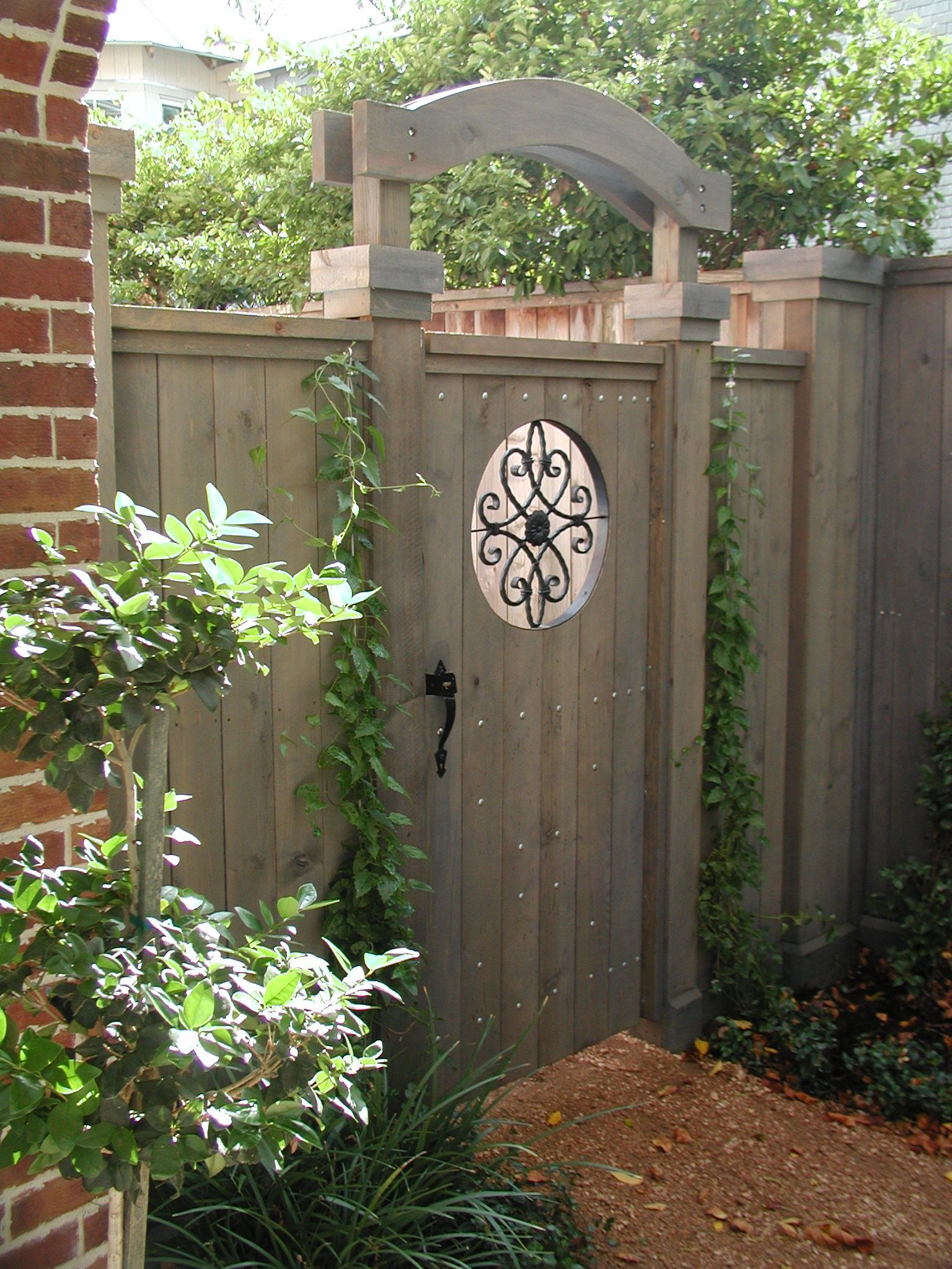Lovely private garden gate with planter and round window GARDEN