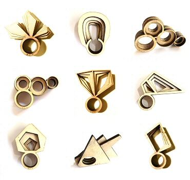 burnt, laser cut plywood rings - UK-based Cypriot jeweller/architect MCP (Maria Christina Papaleontiou)