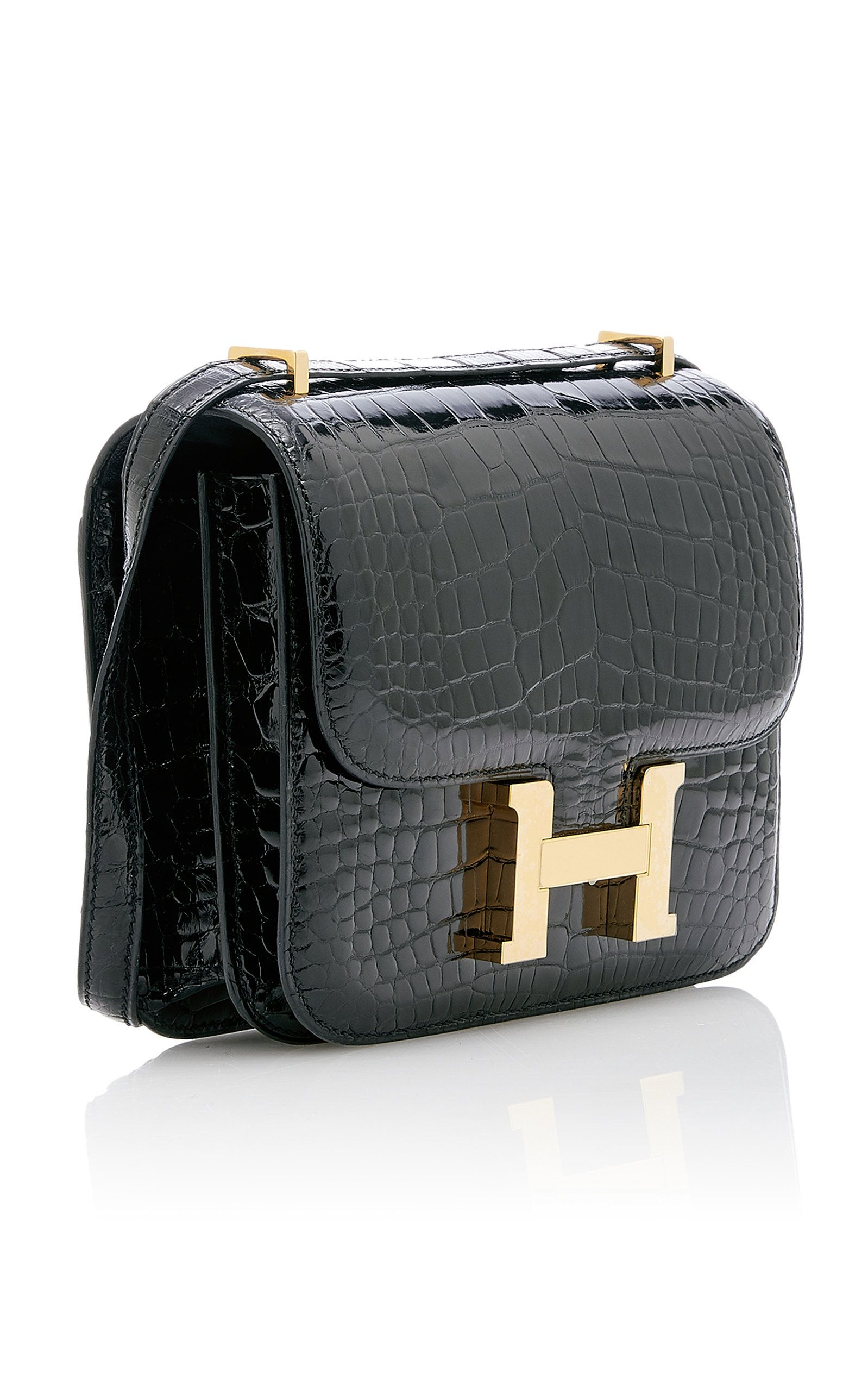 be92b27aa2 Hermès 18cm Shiny Black Crocodile Constance by HERMÈS VINTAGE BY HERITAGE  AUCTIONS for Preorder on Moda Operandi