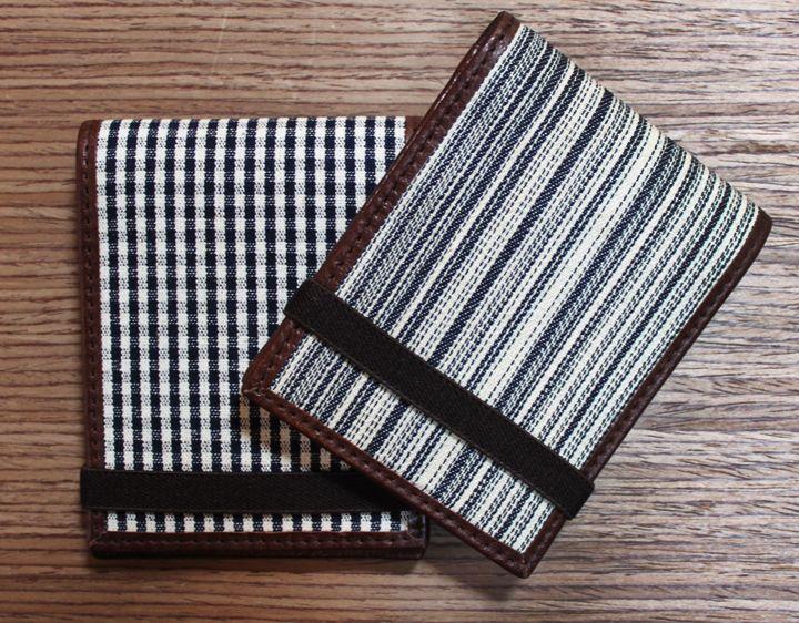 Great new small wallets.  www.stitchchicago.com
