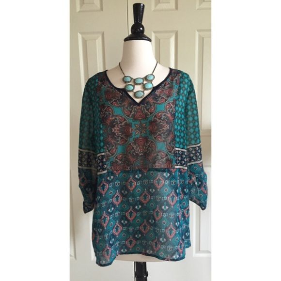 """Dress Barn Super cool and floaty DressBarn tunic * 100% polyester, light and floaty.  * I suggest a camisole underneath, it is a little shear.  * Has a boho look, the sleeves are rolled up and buttoned.  * Machine wash, delicate  * Worn just a couple of times, in excellent condition.  * Measures 27"""" long. Price is firm. Bundle for discounts Dress Barn Tops Tunics"""