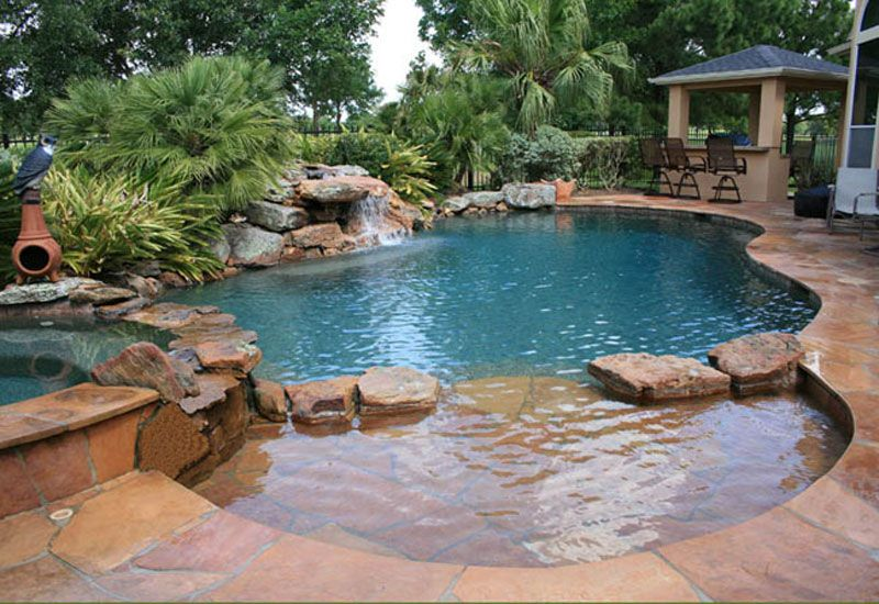 Swimming Pool Ideas the magic hands of barrier reef designs on swimming pool designs for small yards swimming pool ideas for small backyards with splash water fall Natural Swimming Pool Design Ideas With Personable Swimming