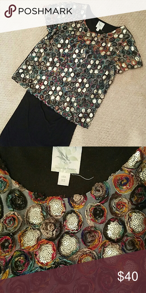 Weston wear Anthropolgie top Glamorous casual, Weston wear Anthropolgie. Rosette and sequin detail,  but still understated. So many compliments on this top. Love. Anthropologie Tops