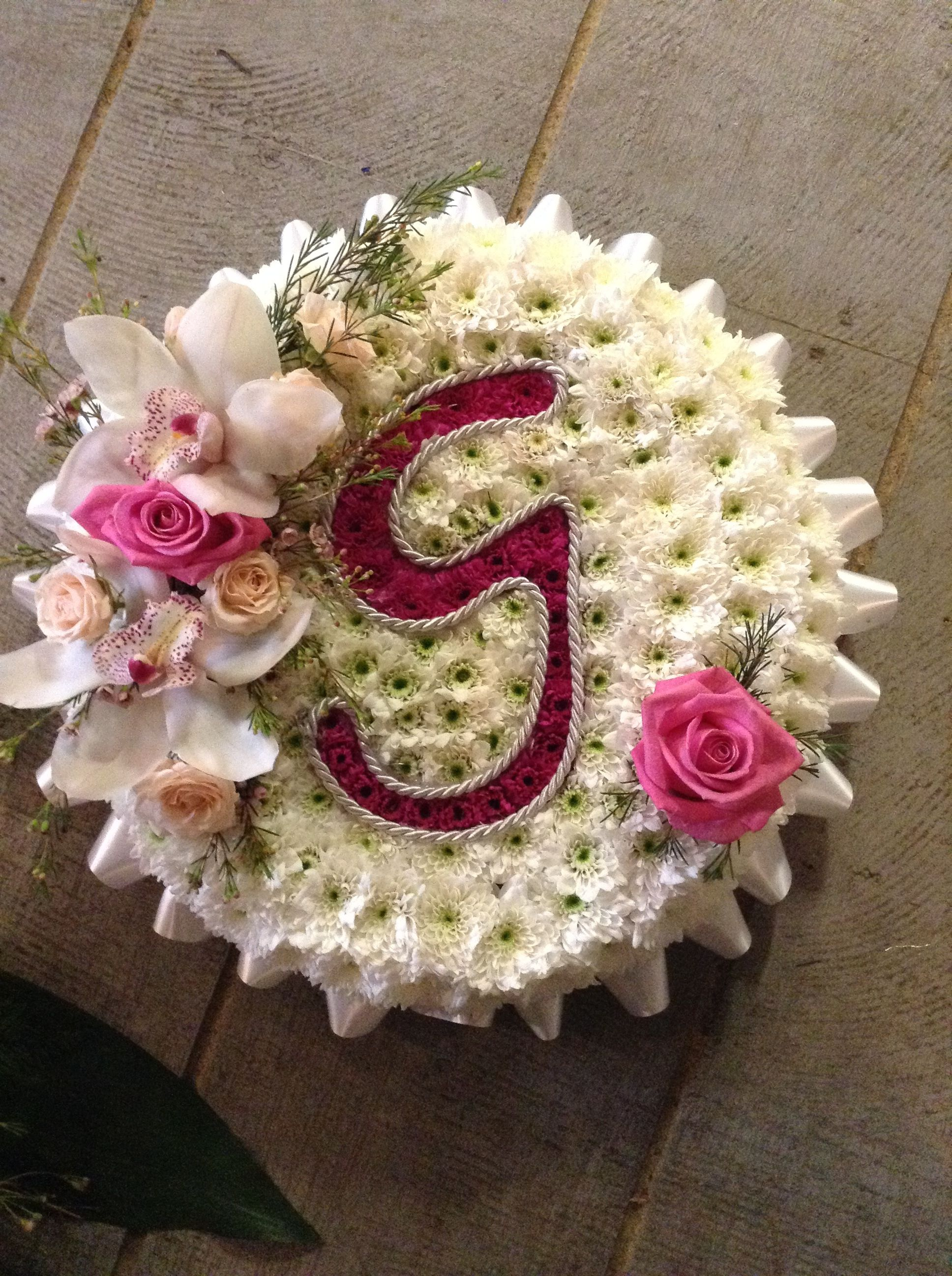 Funeral flowers beautiful personal posy for a funeral pink and beautiful funeral flower posies made by your local professional florist flower shop manningtree colchester please call 01206 394496 dhlflorist Image collections