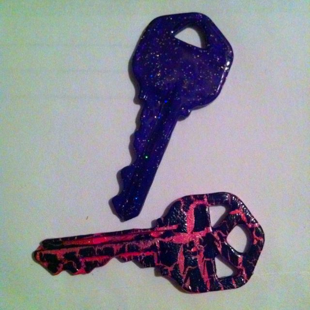 Tired of your boring and identical keys?  Just add some nail polish and it will customize your keys to your style.  I used black crackle and pink on one and purple glitter on the other. Just adds some glam to your key ring.