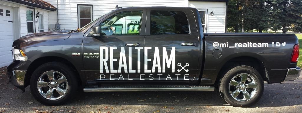 White Business Lettering And Logos Installed On A Black Dodge - Business vehicle decals