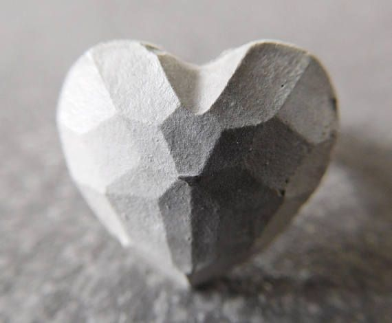 Unusual minimalist ring made of concrete. Heart shaped concrete gem on adjustable silver plated band  You may be thinking, 'But why would I wear concrete?'  Well, its certainly different from the obvious gold, silver or beads. So, while most of us have a traditional view of concrete as something cold, industrial and harsh, its fascinating to take the basic raw material and fashion it into delightful and delicate pieces of jewelry. We all wear jewelry to express our individuality and say…