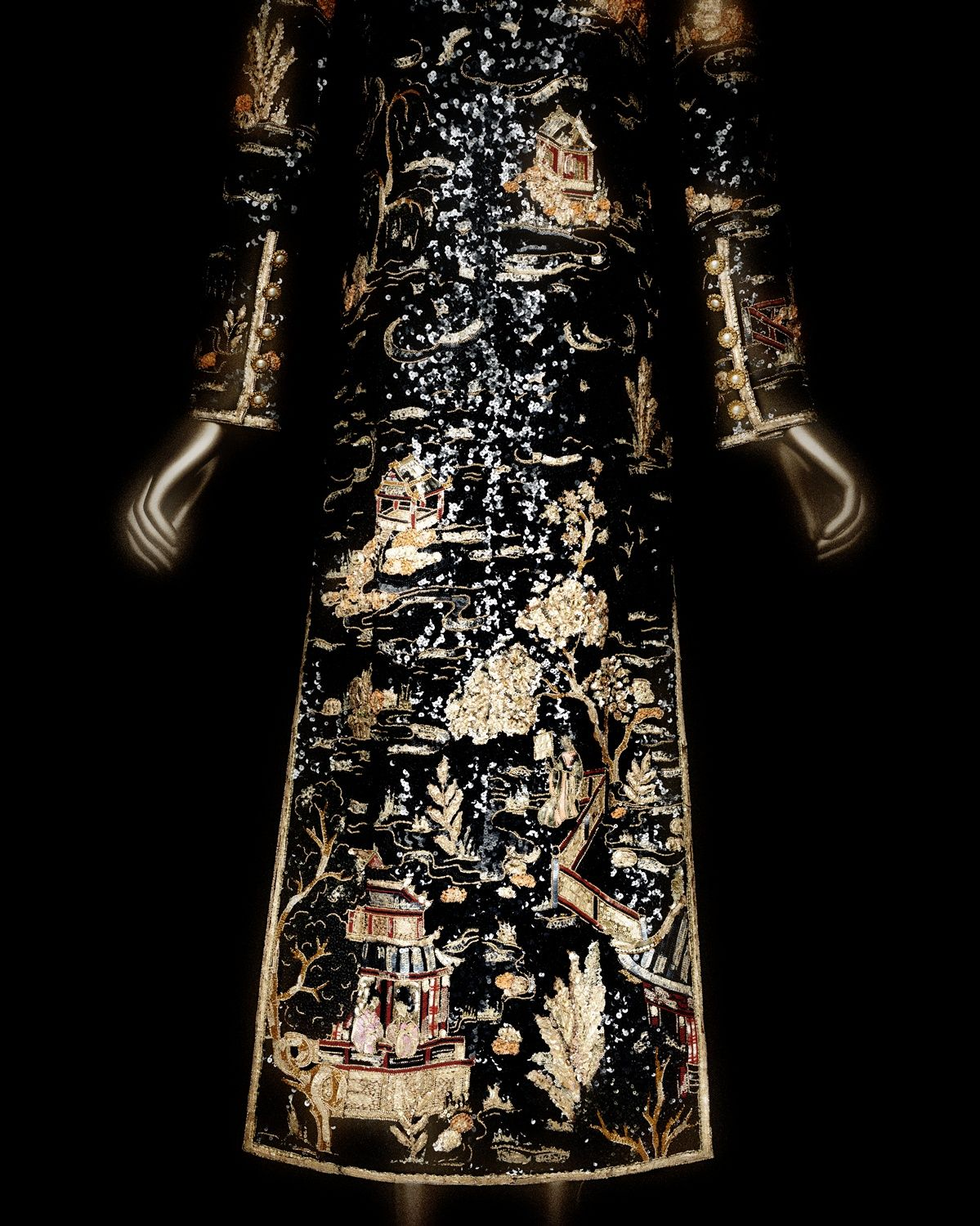 House of CHANEL (French, founded 1913). Karl Lagerfeld (French, born Hamburg, 1938). House of Lesage (French, founded 1922). Evening coat, autumn/winter 1996–97 haute couture. Black silk organza and satin embroidered with black, gold, and coral plastic sequins, and gold beads. Courtesy of Collection CHANEL, Paris | Photography © Platon #ChinaLookingGlass #AsianArt100
