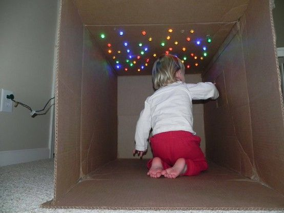"Cave of lights, cardboard box and christmas lights toddler fun -- add a blanket, pillow and a few books for a ""Reading Cave""!!"