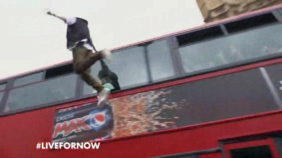 Popular English magician Dynamo is filmed levitating from the side of a branded London bus while crossing the Westminster Bridge for Pepsi Max. Agency: Arnold London.
