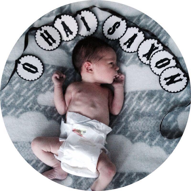 Newborn baby photo Newborn with letter bunting