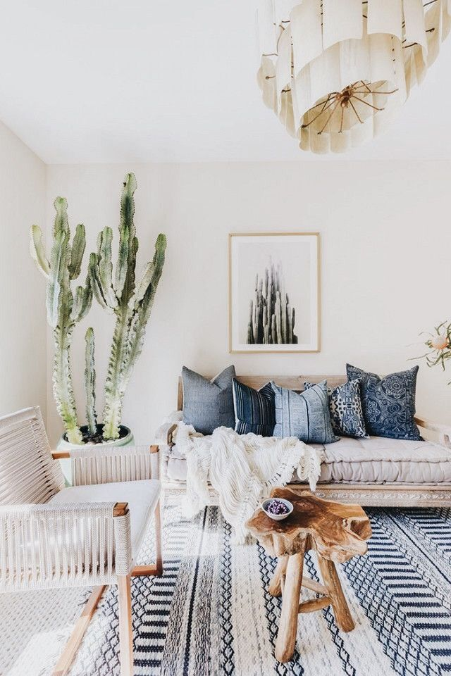 blue and white neutral living room with boho decor ...