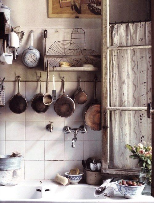 Hang pots, pans, and kitchen tools from the wall or the ceiling for easy access. #inspiredkitchen